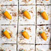 carrot sheet cake in the pan with frosting carrots