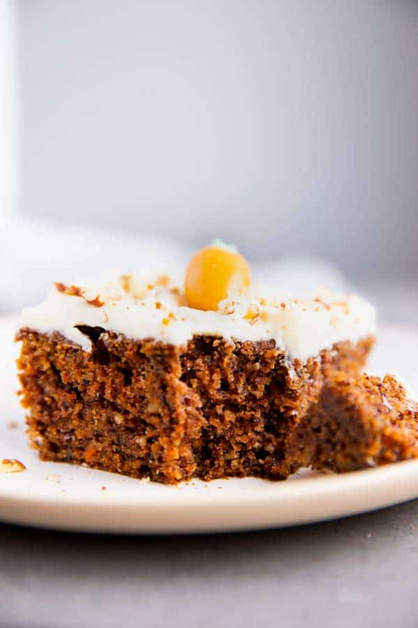 slice of carrot cake with a bite taken out