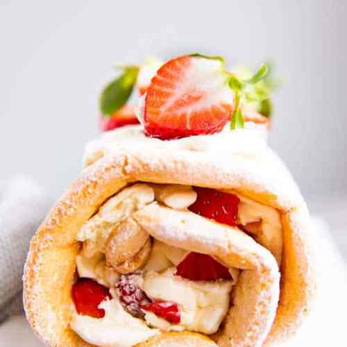 strawberry cake roll on a white plate