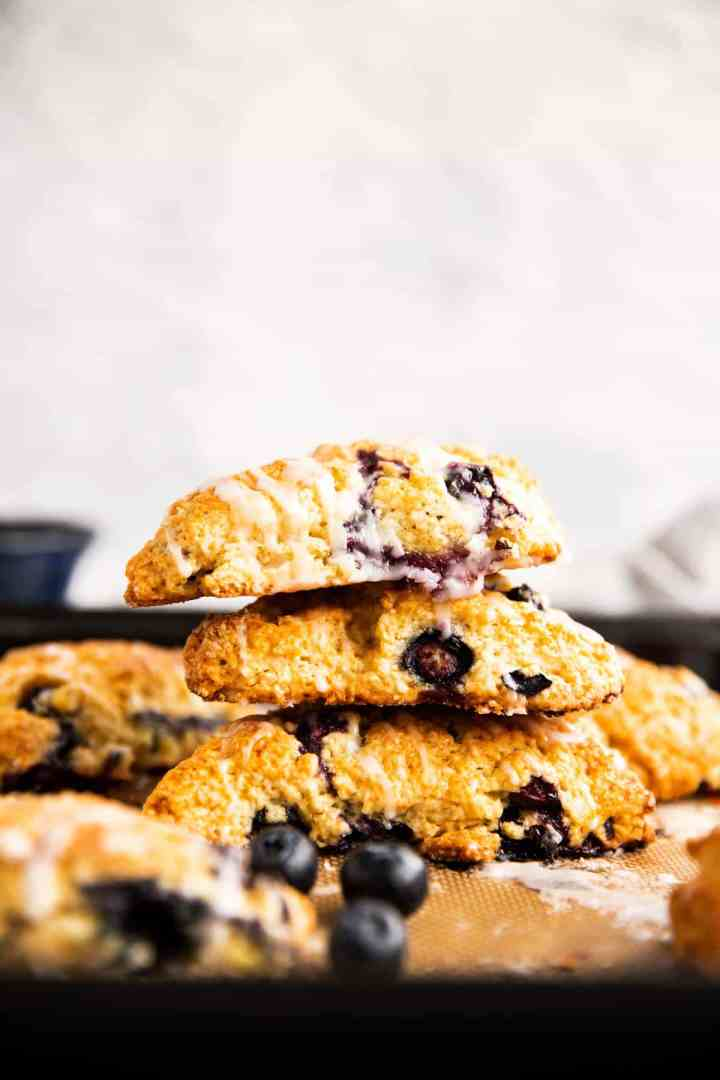stack of blueberry scones on a sheet pan