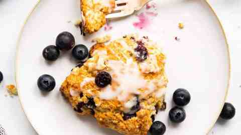 top down view on plate with blueberry scone and fork