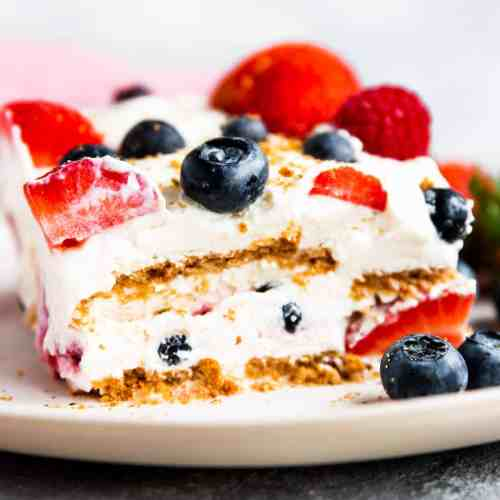 slice of icebox cake with berries on a white plate