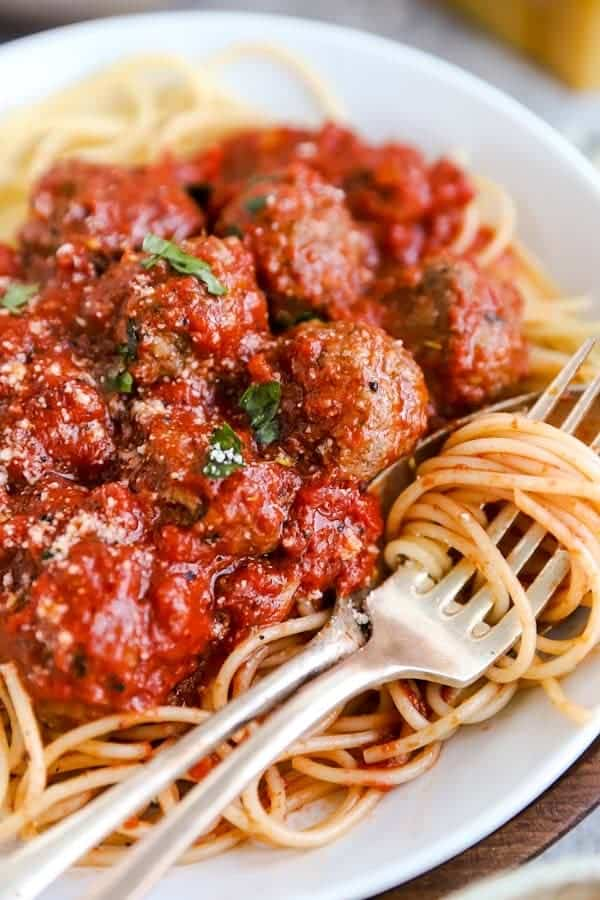 close up photo of a plate with spaghetti and italian meatballs