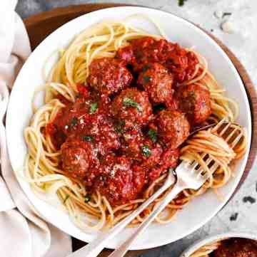 white plate with spaghetti and meatballs