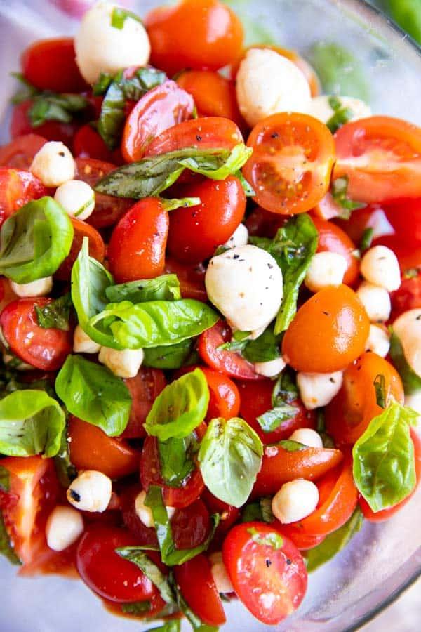 close up photo of a bowl of caprese salad