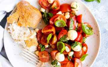 plate with caprese salad and bread