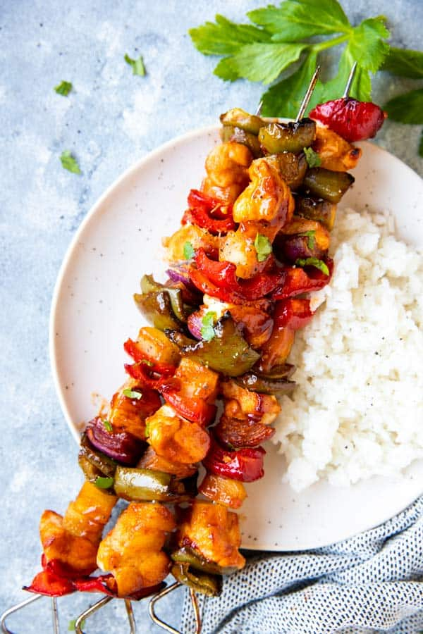 pineapple bbq chicken kabobs on a plate with rice
