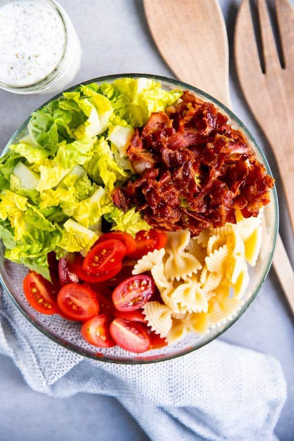 ingredients for blt pasta salad in a bowl
