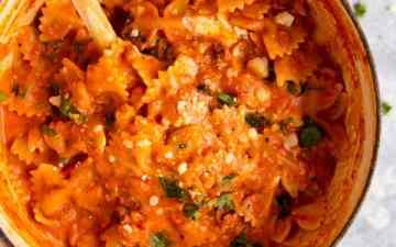 red pot with creamy tomato pasta