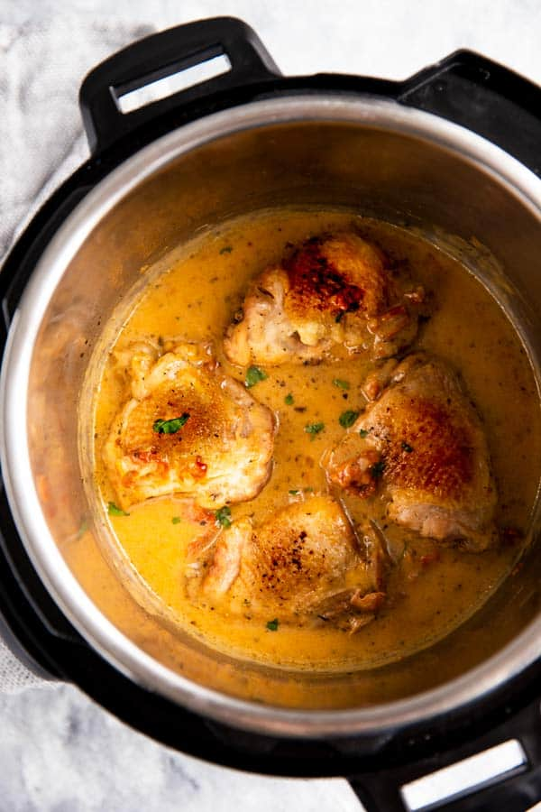 instant pot with chicken thighs in creamy sauce