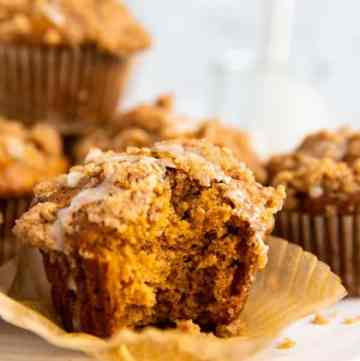 pumpkin crumb muffin with a bite taken out