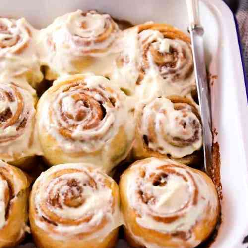 pan with frosted cinnamon rolls