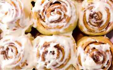 close up photo of a pan full of homemade cinnamon rolls