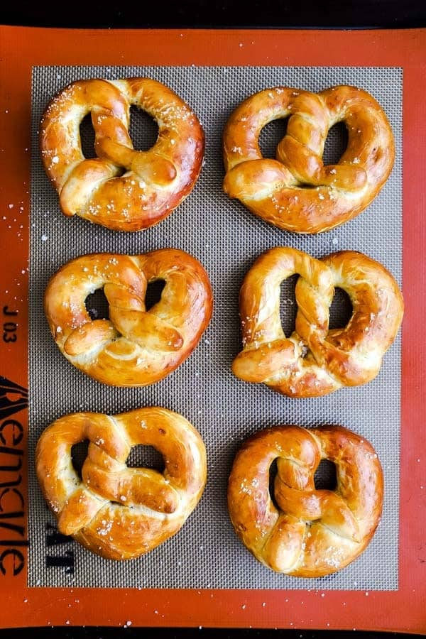 baking sheet with baked German soft pretzels