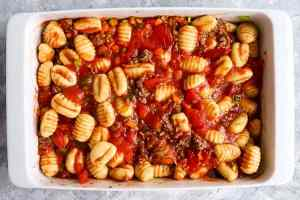 unbaked gnocchi bake in a white dish