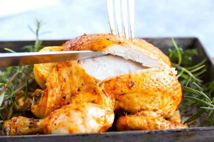 slicing a rotisserie chicken
