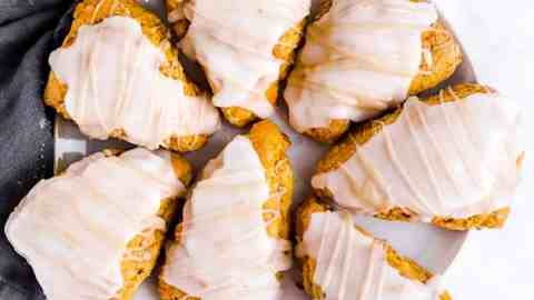 glazed pumpkin scones on white plate