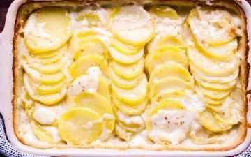 casserole dish full of scalloped potatoes