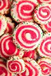 pile of pinwheel sugar cookies in holiday colors