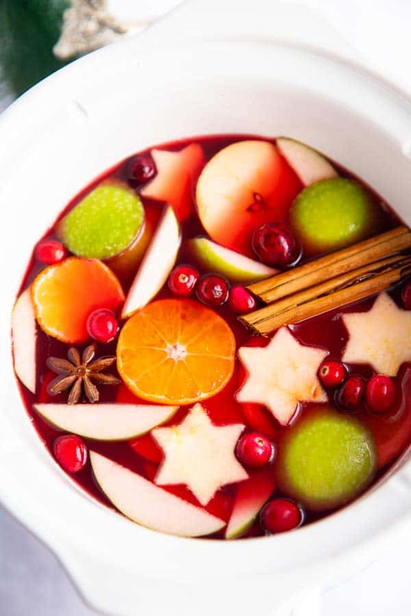 close up photo of a crockpot with Christmas punch