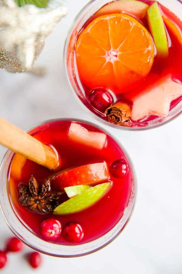 two glasses of Christmas punch on a marble surface