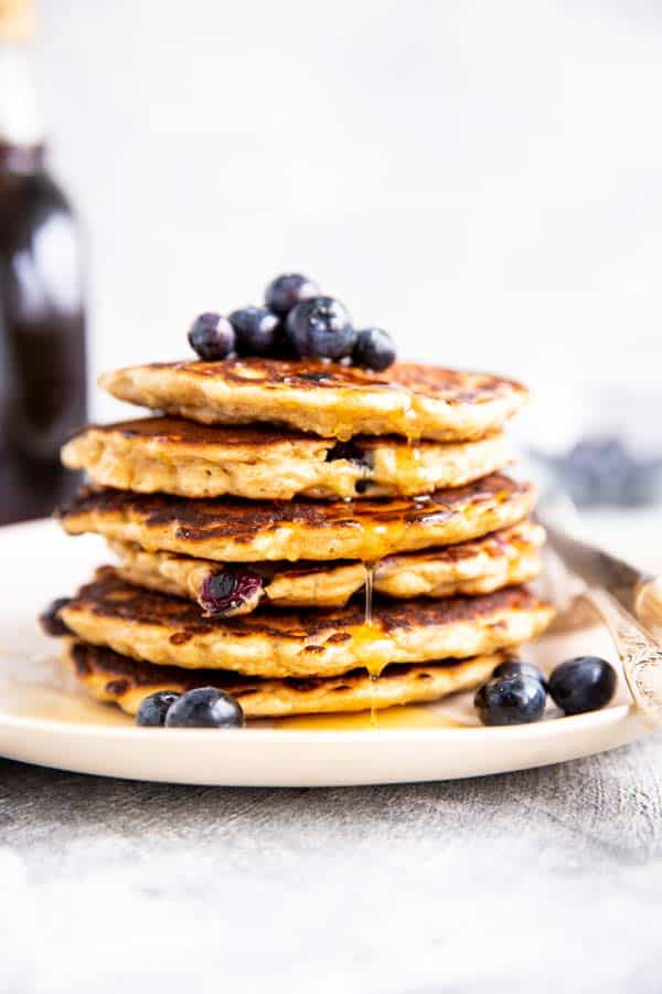 stack of oatmeal pancakes with blueberries on top