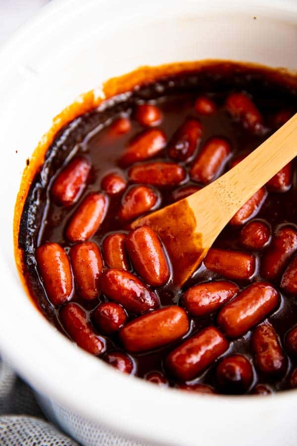 close up photo of crockpot with little smokies in sauce