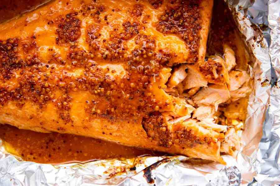 photo of salmon side with maple dijon glaze on a piece of aluminum foil