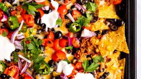 top down view on the corner of a pan with nachos