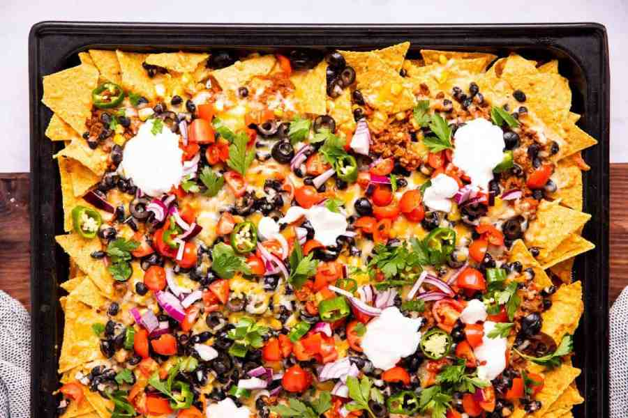 top down view on a sheet pan filled with nachos