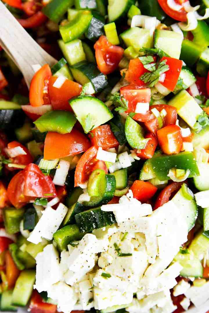 close up photo of diced salad vegetables and cheese