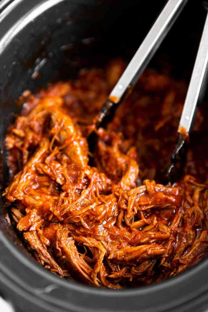 close up of pulled pork in crock