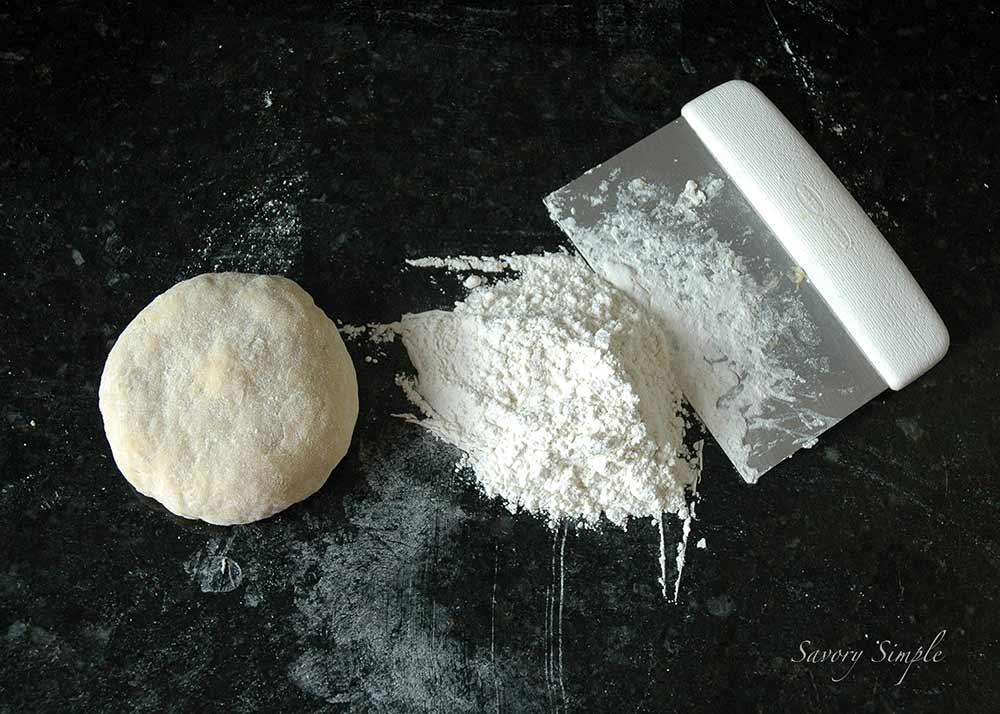 fresh pasta dough with a bench scraper