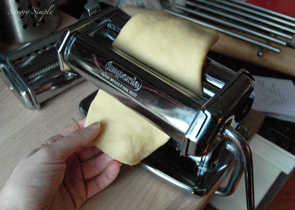 fresh pasta pulled through a pasta machine