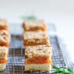 Side angle of rosemary apricot bars, highlighting filling