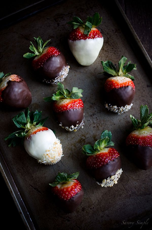 A tray with topped with assorted chocolate covered strawberries