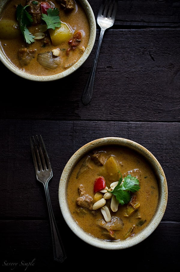 Homemade Thai curry in bowls, shown from overhead on a dark background.