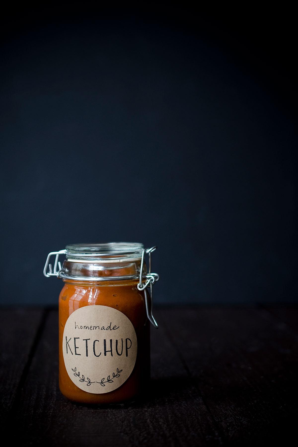 A photo of homemade ketchup in a mason jar