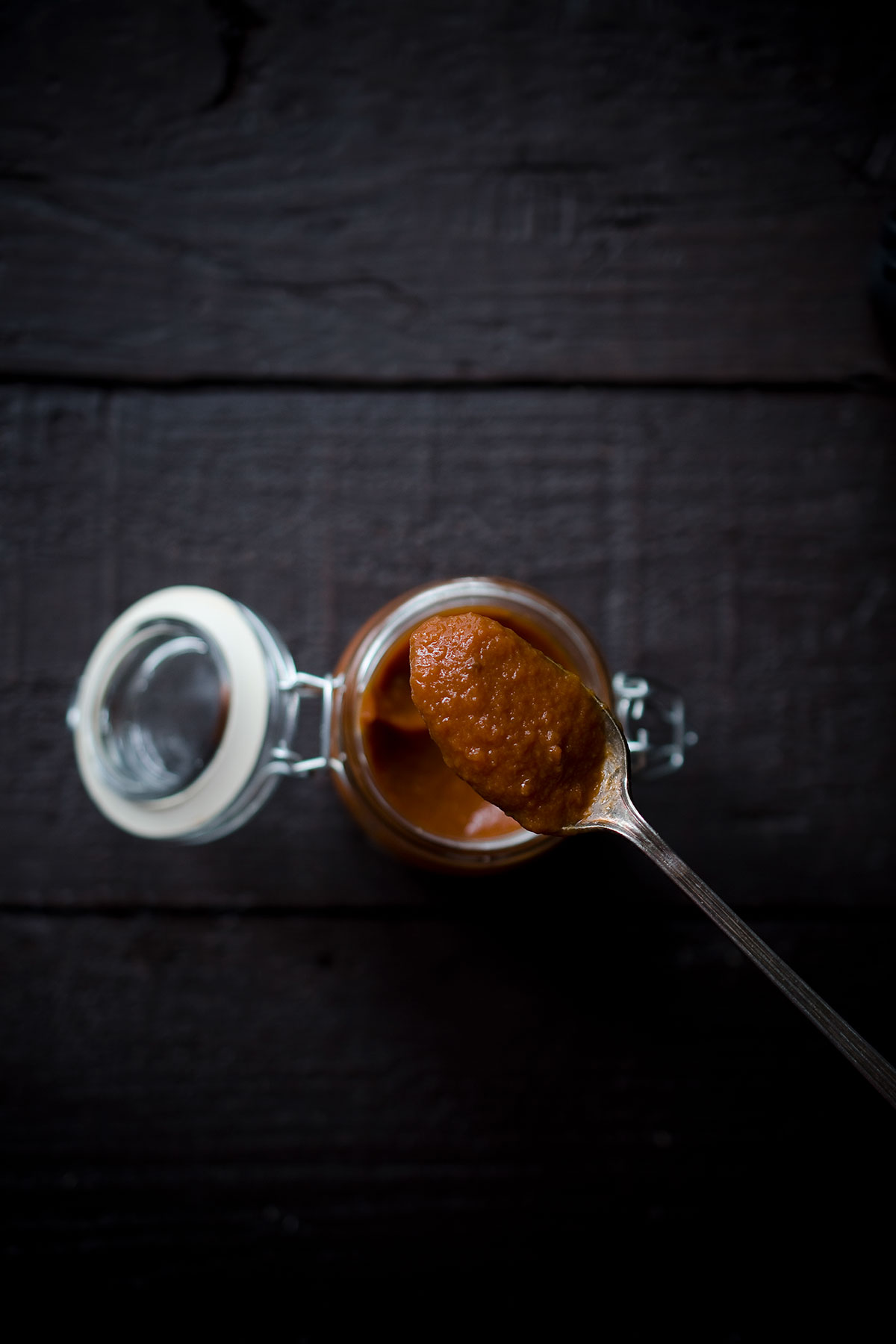 A spoon showing a closeup of this homemade tomato ketchup recipe