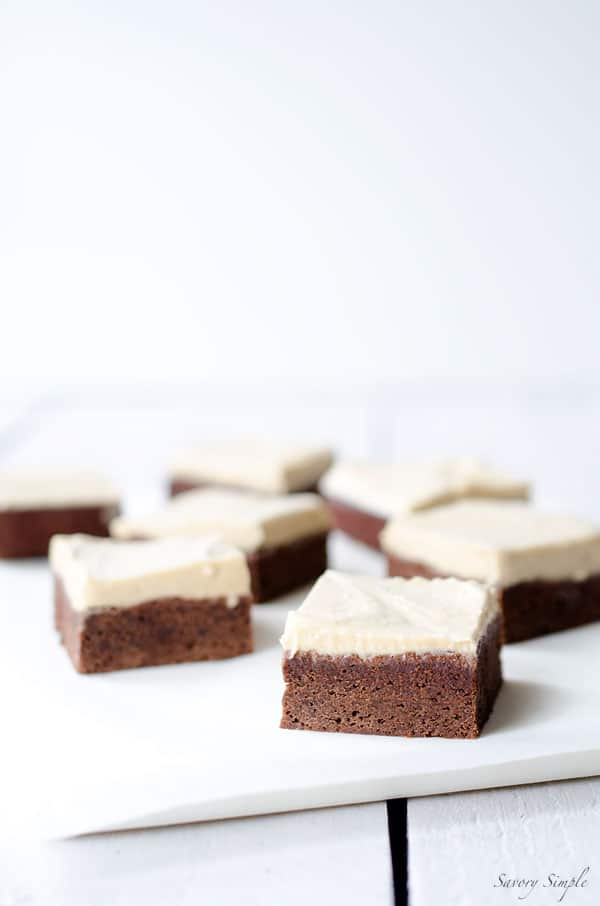 These Chocolate Brownies with Salted Tahini Frosting are a simple, decadent dessert. Get the easy-to-follow recipe from SavorySimple.net