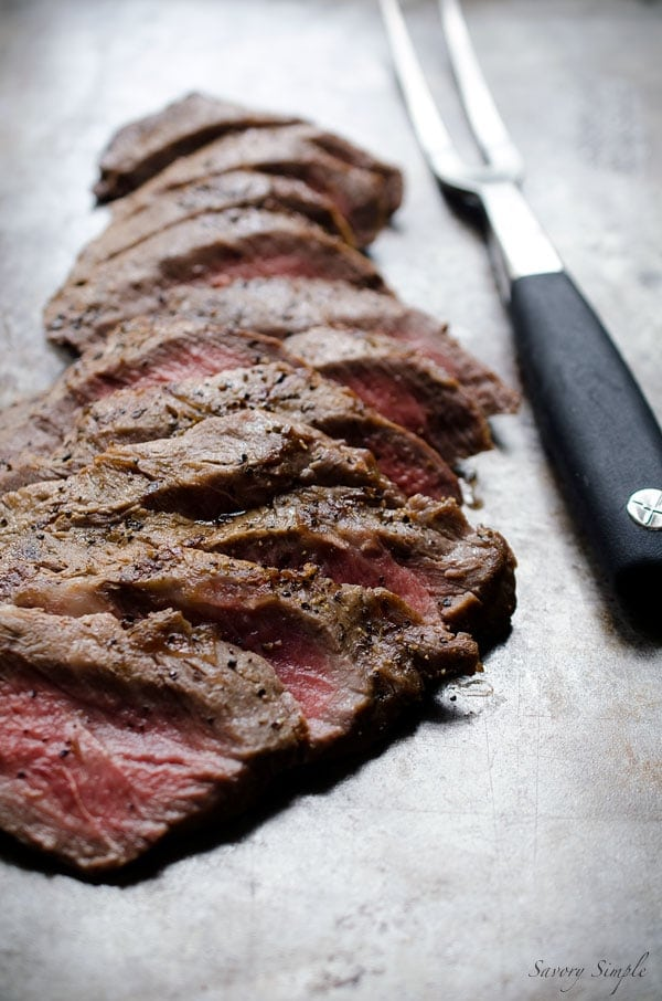 This Beer Marinated Grilled Flat Iron Steak is a perfect summer dish! It also makes an amazing filling for tacos. Get the easy recipe from SavorySimple.net