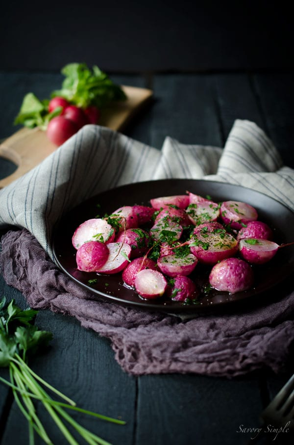 Roasted Radishes with Brown Butter and Parsley - a simple, low carb, vegetarian side dish that's incredibly flavorful and easy to prepare! Get the recipe from SavorySimple.net.