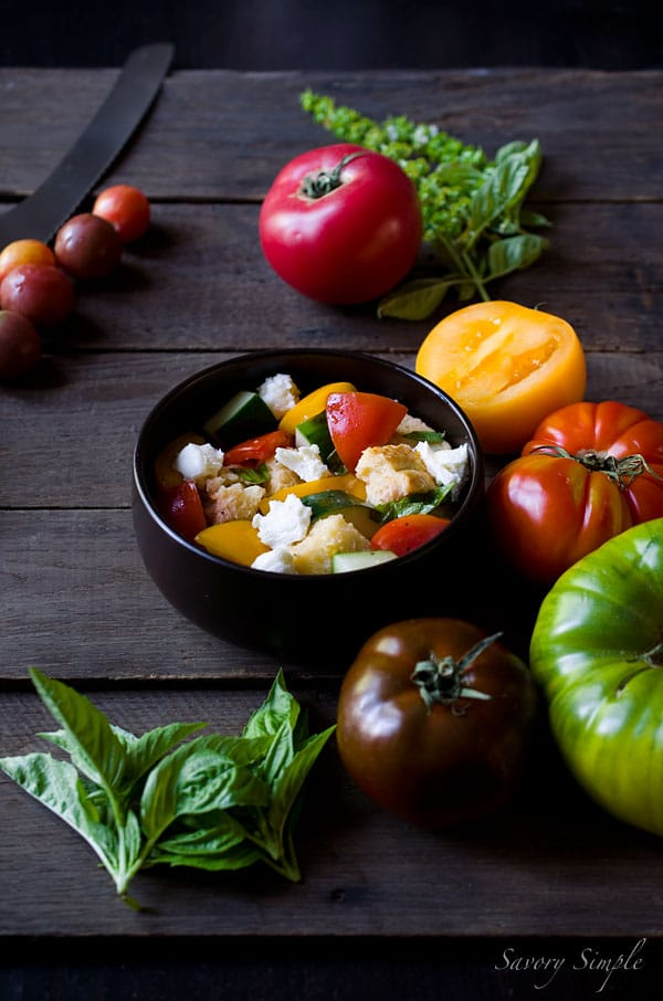 This Heirloom Panzanella Salad is a perfect way to enjoy summer's most beautiful tomato! Get the recipe from SavorySimple.net