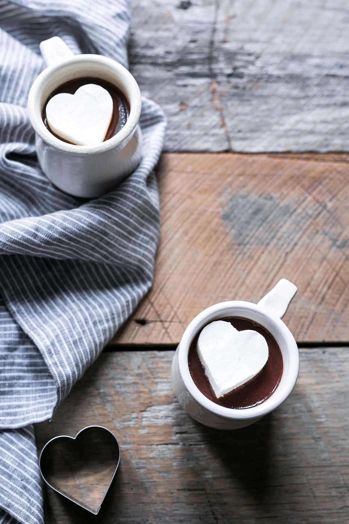 A photo of Hot Chocolate topped with Whipped Cream Melting Heart