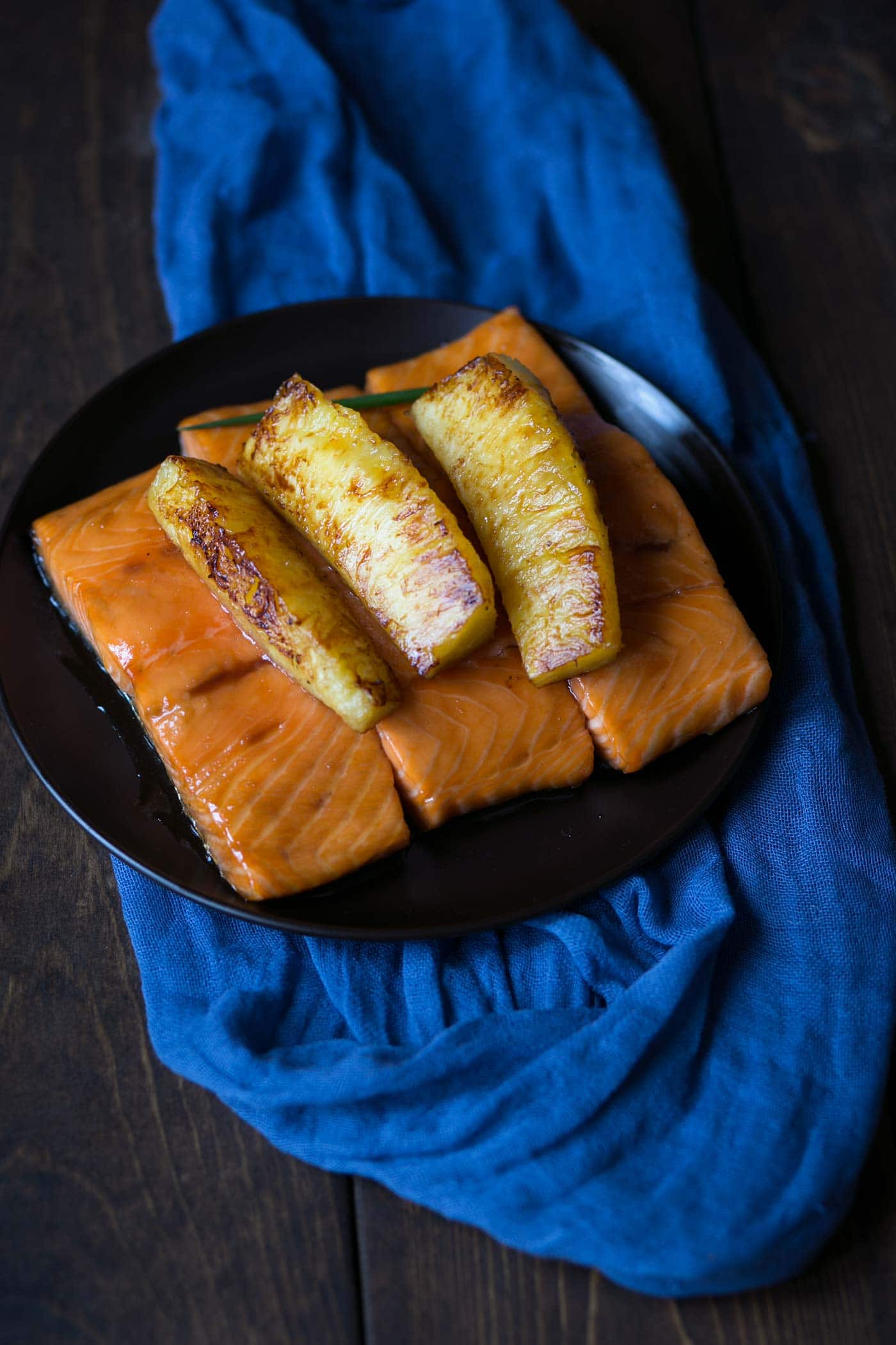 This baked Honey Soy Glazed Salmon with Caramelized Pineapples is a tasty, easy meal with only a few simple ingredients! Dinner is ready in under an hour (and that's mostly inactive). SavorySimple.net