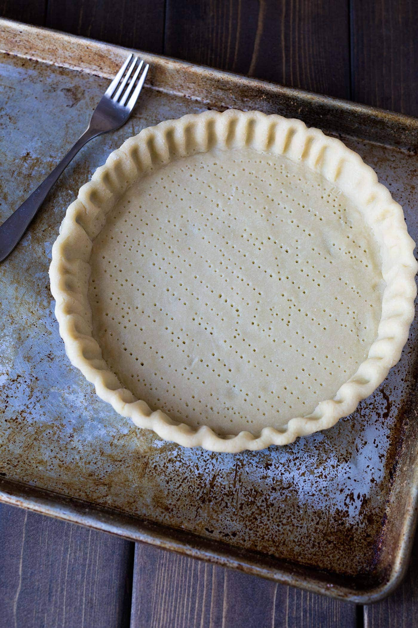 A photo of docked tart dough.