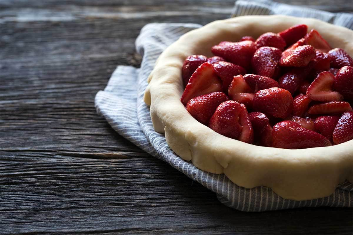 Macerated strawberries in homemade pie dough.