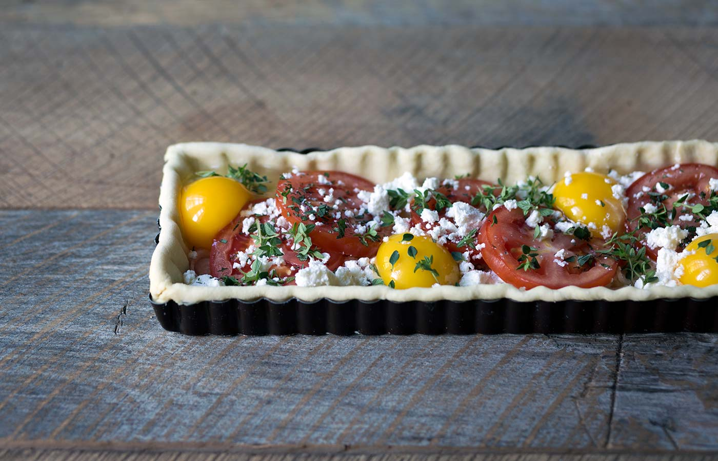 This Tomato Feta Egg Tart is perfect as an appetizer, side dish, or even for breakfast. It's beautiful and incredibly delicious. SavorySimple.net