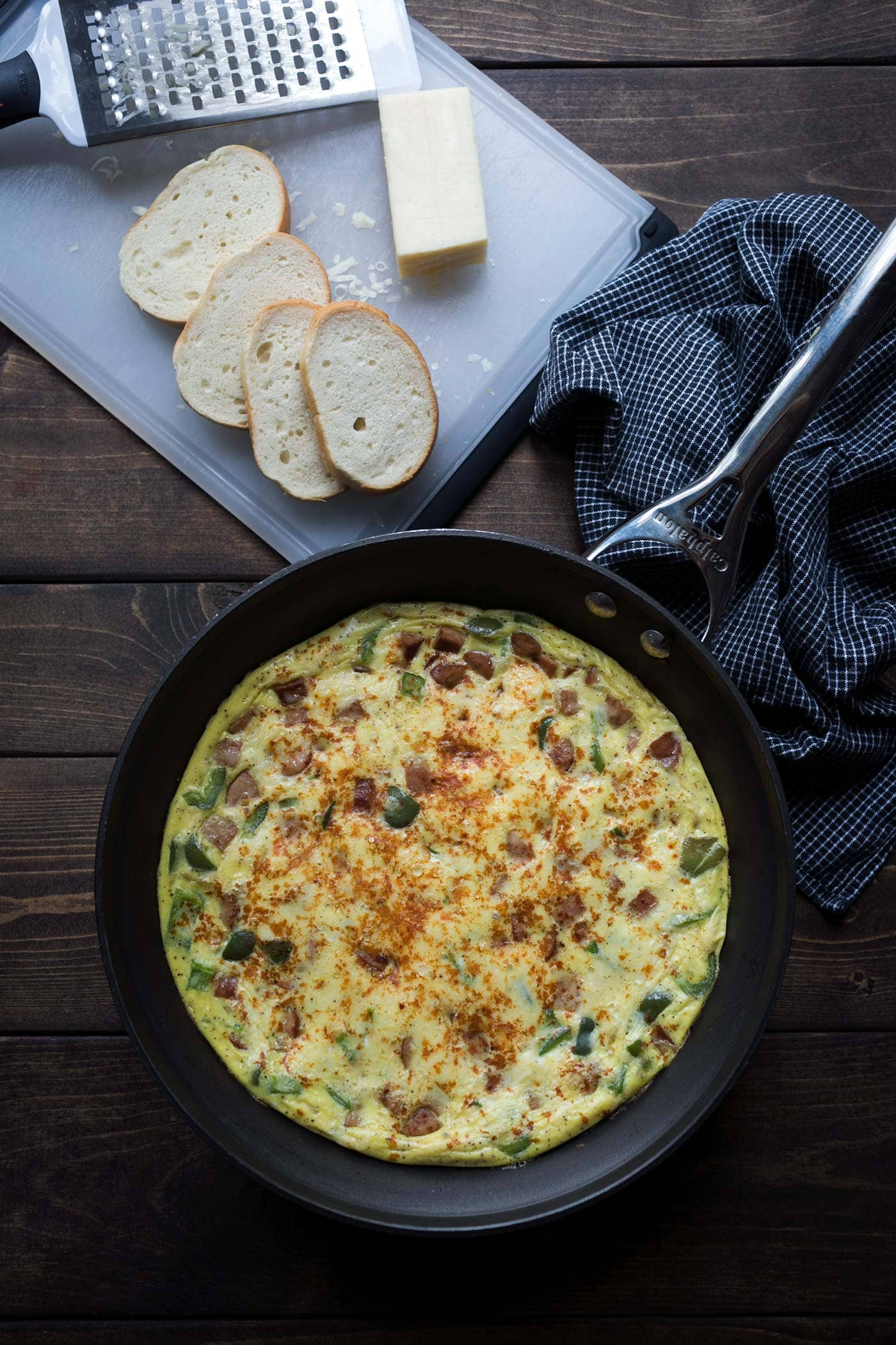 This Smokey Andouille Sausage Frittata is a perfect breakfast for powering through the week! It's also a lovely weekend brunch option. SavorySimple.net