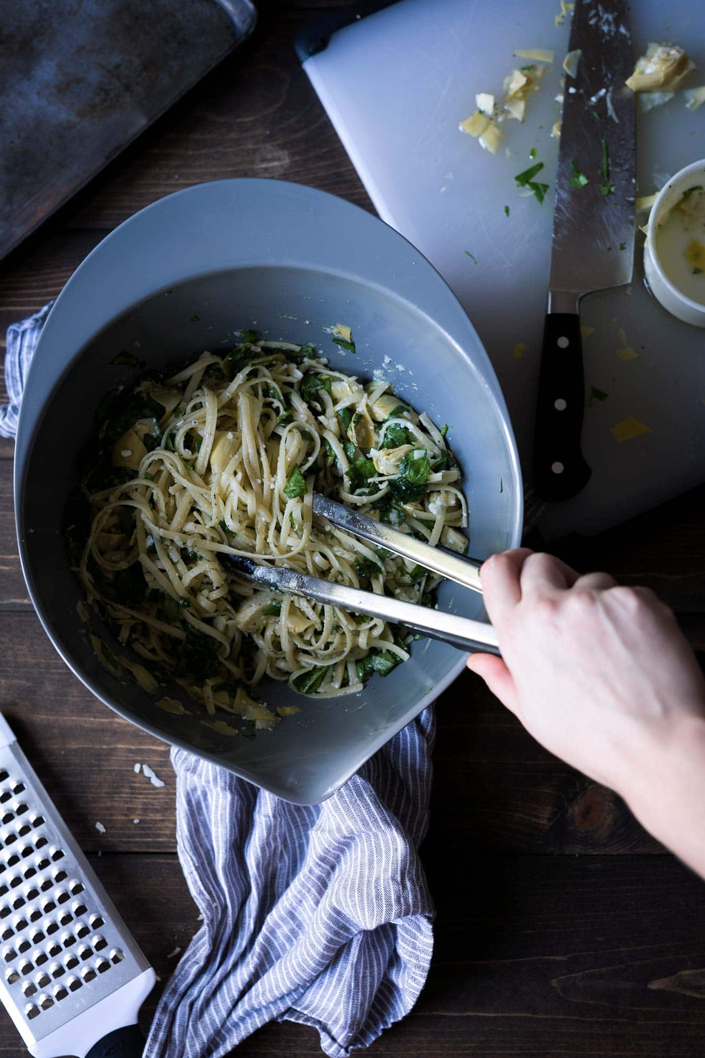 Cheesy Spinach and Artichoke Pasta is a simple, comforting meal that comes together in less than 20 minutes. Only 6 ingredients! SavorySimple.net